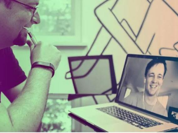 Photo of two men video chatting